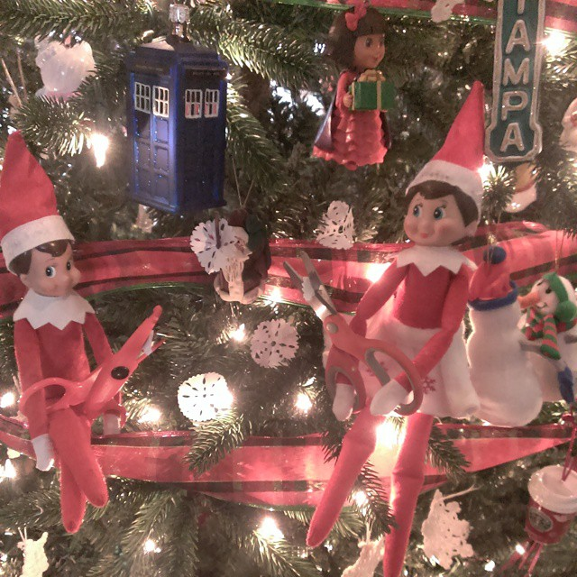 Day 12 #elfontheshelf escapades: Giggles and Twinkle made paper snowflakes. #yesthereisaTARDISinmytree and #TampaTheatre sign. #TARDIS #DoctorWho #Tampa
